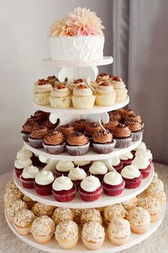 Not these colors but a set up like this with small wedding cake at the top and cupcakes around bottom.