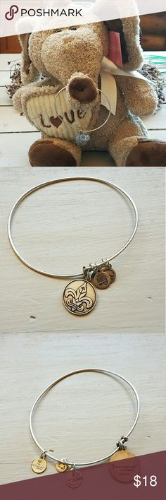 """Alex and Ani fleur-de-lis adjustable bracelet This bracelet is from the Alex and Ani energy technology 2014 line. This is a silver finish, in excellent condition with minimal sign of wear.   """"Associated with the Holy Trinity, the Fleur de Lis represents faith and life. In ancient texts it was a symbol of the eternal flames of the heart: love, wisdom, and power. Let the Fleur de Lis be your three-part reminder of the divine fire within you."""" Alex & Ani Jewelry Bracelets"""