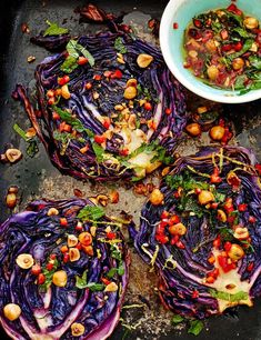 Roasted Cabbage Steaks With Hazelnut Dressing This easy recipe for roasted cabbage steaks makes a subtly sweet and zesty low calorie vegetarian main for four. Keep any left-over cabbage and make our pickled red cabbage on Asian chicken burgers or spice it Vegetarian Roast Dinner, Low Calorie Vegetarian Meals, Vegetarian Steak, Roasted Cabbage Recipes, Roasted Red Cabbage, Red Cabbage Recipes, Grilled Cabbage, Cooked Cabbage, Kohl Steaks
