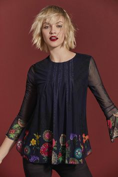 Desigual Women's blue chiffon long-sleeved T-shirt with floral print at the hem and sleeves. Discover Desigual Women's New Collection!