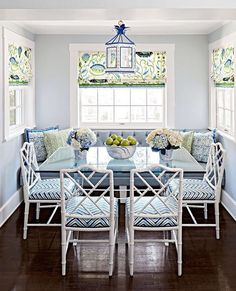 Midwest Living This wonderful breakfast nook features a blue, white, and green palette and Chinese Chippendale chairs.