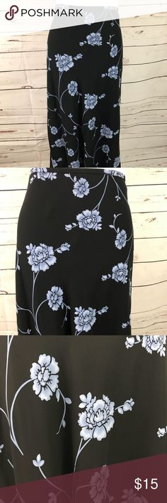 Beautiful black skirt with perinwinkle blue floral 100% silk black ankle length skirt with periwinkle floral design.   EUC Casual Corner Skirts Maxi
