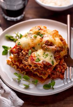 The Best Homemade Lasagna Recipe is cheesy, meaty, saucy, and SO delicious!!! And while this recipe requires a bit of work, it can be made ahead of time and stored in the fridge for up to 24 hours before baking. A hearty recipe that's perfect for feeding large groups! #lasagna #lasagnarecipe