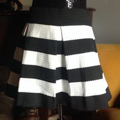 "Plus! Touch Me Bandaged Striped Skirt Love this skirt, however it's too mini for me. Bandaged Ponte black & white skirt. Zips in the back. The material is kind of thick, but stretchable. Length of skirt 16 1/2"". Made out of 100% polyester. Touch Me Skirts Mini"