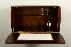 Midcentury Bar with Pepe Mendoza Hardware | From a unique collection of antique and modern dry bars at https://www.1stdibs.com/furniture/storage-case-pieces/dry-bars/