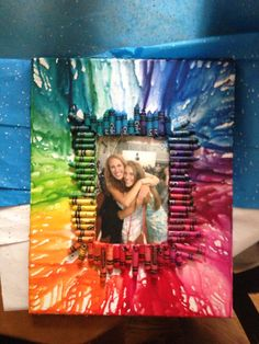 DIY CRAYON DRIP FRAME: 1. buy a canvas the size you want 2. glue down your picture 3. hot glue crayons around your picture. 4. take a hair dryer and melt the crayons one side at a time, holding the frame so that the crayon drips the direction you want/away from your photo