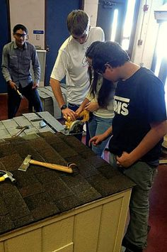 """New Mexico Teens build dog houses.  """"It teaches the kids the importance of giving animals shelter, rather than tying the dog to a pole outside without protection from the weather."""""""