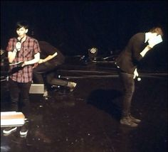 Phil is singing and Dan is hiding his face in shame…