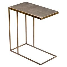 Form meets function in this durable, dramatic end table. Modern lines crease the base, crafted from antique brass. The wood top gets a makeover in neutral khaki colored faux shagreen that varies natural and brings organic texture to the piece. The 'C' shape tucks up to sofas with ease. Minimal and modish, this accent table works perfectly in a smaller spaces, but it lives large in style.
