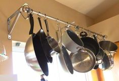 DIY HANGING POT RACK – if space is an issue in your kitchen, you can solve that problem in mere minutes thanks to a curtain rod, 2 brackets, S-hooks and a screw driver! I would use cuter brackets though. Pot Rack Hanging, Hanging Pots, Diy Hanging, Window Hanging, Small Space Organization, Kitchen Organization, Organization Hacks, Organizing, Diy Curtain Rods