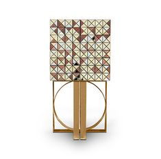 Pixel is a cabinet united by design and craftsmanship. A cabinet with silver and gold leaf with ten types of wood and mirrors. | Boca do Lob | Luxury Furniture | www.bocadolobo.com/en