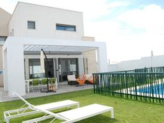 Villa design with private pool and garden next to the beach, up to 14 people - Conil de la Frontera Villa Design, Private Pool, Swimming Pools, House, Outdoor Decor, Travel, Products, Andalusia, Parking Space