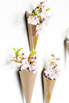 #DIY hanging flower cone wall #decor. I wonder if paper tubes would work in place of card stock.
