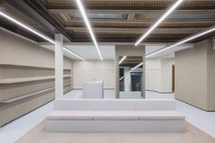 Collage The Shop in Aarhus, Denmark by Studio David Thulstrup, Photo by Irina Boersma. Aarhus, Polyurethane Floors, Two Store, Interior Architecture, Interior Design, Luxury Store, Curved Walls, Collage, Metal Shelves