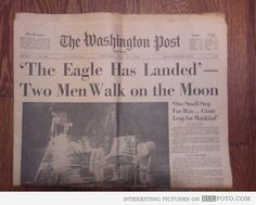 "The Eagle Has Landed -- 43 years ago - Old newspaper with Moon Landing headlines: ""Two Men Walk on the Moon."""