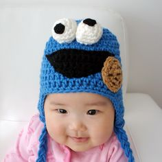 For Owen? Haha... she has a lot of cute girlie ones, too.  Cookie Monster Hat, Speedy, Crochet Baby Hat, Baby Hat, Animal Hat, photo prop, red, Inspired by Cookie Monster on Sesame Street. $19.99, via Etsy.