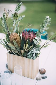 There's something so lovely and fresh about the way @mollymadfis used plain wooden planter boxes for her #DIY wedding centerpieces. (Plus you can actually reuse them after the big day.)