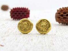 Handmade, one of a kind post earrings made of 24k solid gold, with an organic look and unique texture.  The back of the earrings is made of 9k solid gold