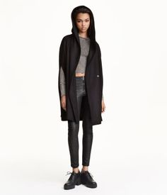 CONSCIOUS. Cape in a felted wool blend with a lined hood, concealed snap fasteners at front, and openings at sides for arms. Lined. Wool content is recycled.