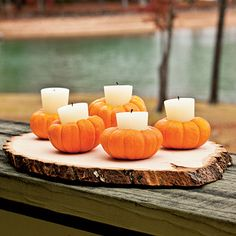 Make Custom Candleholders | Transform mini pumpkins into luminarias by cutting a 1-inch-wide circle into each pumpkin, scooping out the centers with a tablespoon, and inserting votive candles.