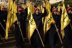 Members of Lebanon's Shiite Hezbollah scout movement march during commemorations marking Ashura in a southern Beirut suburb. (PATRICK BAZ / AFP)