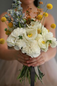 Beautiful + Simple!  Love the pop of Yellow!  via Wedding Chicks Wedding Blog