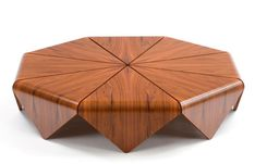 "We love the ""artisan"" quality of this handmade modern wood table by Brazilian company Etel. Dubbed the Petalas, this exotic table is inspired by a flower, with it's petals."
