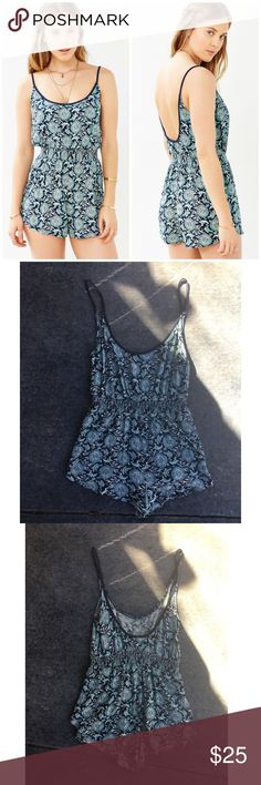 Urban Outfitters Ecote Natasha Romper Urban Outfitters Ecote Natasha Romper. Gorgeous low back floral romper features elastic waist and spaghetti straps. 100% rayon.  Dry good condition. 🌵bundle to save, offers welcome🌵 Urban Outfitters Pants Jumpsuits & Rompers
