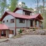 Wildwater's Corkscrew Cabin Front View with Arched Entry Truss - Houses - Exterior - Timber Frame HQ - http://timberframehq.com/timberframephotos/houses-exterior/?utm_content=buffere056d&utm_medium=social&utm_source=pinterest.com&utm_campaign=buffer