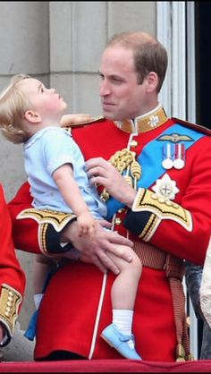 June 2015 ~ Prince William, Duke of Cambridge holds his son, Prince George, as they stand on the balcony of Buckingham Palace during the annual Trooping the Colour.