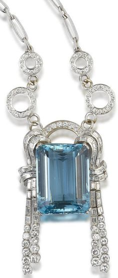 An aquamarine and diamond brooch, by Bulgari.     The brooch set with an emerald-cut aquamarine, framed to each side with an articulated stylised tassel, set with baguette and round brilliant-cut diamonds, accompanied by a detachable diamond-set necklace chain, mounted in platinum, the aquamarine estimated to weigh 86.80 carats, the diamonds estimated to weigh 7.50 carats in total to the brooch and 3.10 carats in total to the necklace, the brooch signed 'Bulgari', maker's case. Via Bonhams.