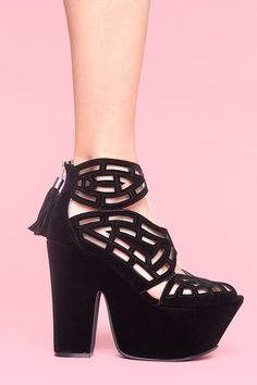 Not that I need yet another pair of black wedges/thick heels, but...