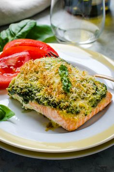 Baked Salmon Pesto with slices of tomato for dinner.