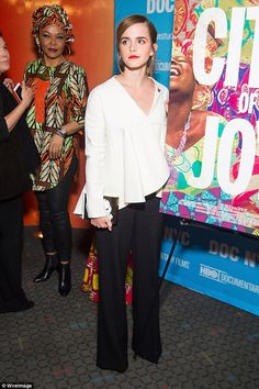 Simple style! The 25-year-old star kept it chic in black trousers and a white blouse...