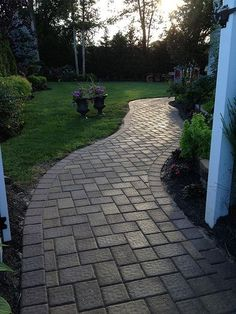 This beautiful walkway was created by Stone Creations of Long Island using Cambridge Pavingstones with Armortec.