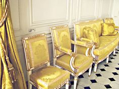 Yellow chairs against an ivory wall at the Palace of Versailles. Photo available on Etsy, © Gypsy Fables.