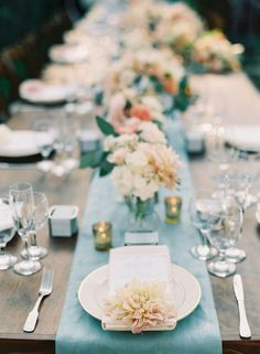 spring wedding table - photo by Caroline Tran http://ruffledblog.com/a-sophisticated-wedding-at-maravilla-gardens #weddingtable #receptions #weddingideas