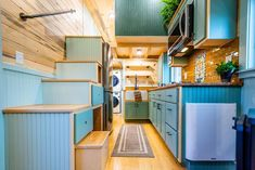 """Custom Gooseneck Tiny House on Wheels by MitchCraft Tiny Homes - """"The Hiatus House"""" Designed by Tongue & Groove Homes for Cottage Commu – Dream Big Live Tiny - Tiny House Builders, Tiny House Plans, Tiny House On Wheels, Tiny House Design, Tiny Cabins, Cabins And Cottages, Tiny House Movement, Minimaliste Tiny House, Galley Style Kitchen"""