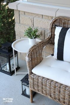 Porch decor tip: Add a small outdoor table to set mail, drinks and plants! See all 10 porch decor ideas from this design blogger's own home!