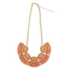 """Cabochons abound in this statement necklace from Minicci. The polished oval and round stones are highlighted by rhinestones atop a chain link necklace with a 9"""" drop, secure lobster clasp and 3"""" extender. Nickel free."""