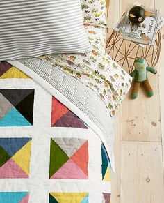 A piece crafted to keep, our color-happy puzzle patchwork is pieced from pure cotton in a modern refresh that transitions easily from little kid to big (and keeps them comfy all the way). Certified by OEKO-TEX® Standard 100, this cotton with cotton fill is soft and breathable for a just-right temperature year round.   <br>•Soft 100% cotton <br>•Pure cotton fill <br>•Pieced patchwork art <br>•Generously sized for plenty of room on each side  <br>•Certified by OEKO-...