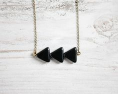 Für Geometrie-Verliebte: Zarte Kette mit schwarzen Pfeilen / cute tiny geometrical necklace, all black by TanteRina via DaWanda.com