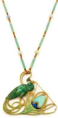 Lalique - 1900 Peacock Pendant. Gold, sapphire, enamel. 5.5 cm. On 48 cm long green enamel & opals rod style chain.