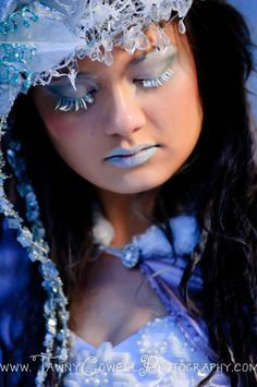 I love the head piece she is wearing with the icicles!