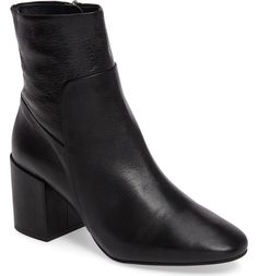 Clean lines underscore the minimalist style of this pointy-toe leather bootie elevated by a chunky wrapped heel.