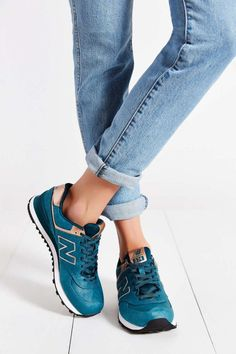 New Balance sneakers go perfectly with rolled up denim.