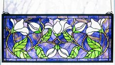 For replicating on front door panels...keeping in mind the blue of the exterior.  Tiffany Stained Glass windows, works of art by Louis Comfort Tiffany and Meyda