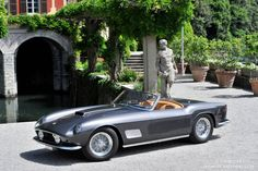 1958 Ferrari 250 GT California Spider Pinned for the water feature in the background.