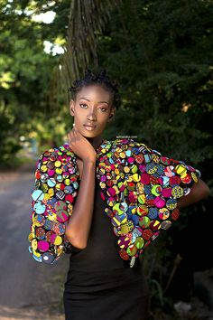 this absolutely beautiful and stylish handmade necklace is made with various african print buttons . this cape can be worn in both ways ( front and back) this cape is adjustable and can be worn with a day or evening outfit and will definately bring a touch of glamour to your outfit ...