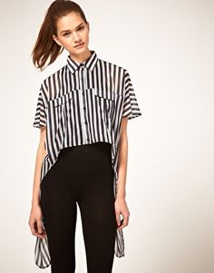 pair a long stripe top tucked in front with black high waisted pants http://rstyle.me/gdw3s8bu6e